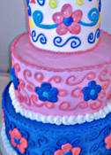 Smoothed Buttercream Icing with Fondant Crown, Piped Flowers and Scroll